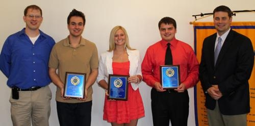 Optimist Club President Todd Nightenhelser (left) and Huntington North High School Principal Chad Daugherty (right) pose with HNHS students (from left) Anthony Beery-Bennett, Audrey Hiner and Zach Shearer, who earned the club's Youth Appreciation awards.