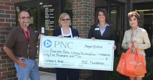 Representatives from PNC Bank present a $45,000 grant to representatives from the Roanoke Public Library at PNC Bank of Roanoke on Tuesday, Aug. 21.