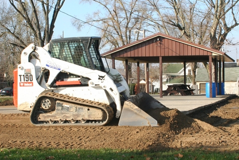 Paul Brinson, of Zahm Excavating of Huntington, works to level part of the lawn in front of the Andrews Park pavilion on Thursday, Nov. 12. The Andrews Park committee recently approved the project, which is part of a beautification endeavor at the park.
