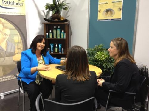 Loretta Mottram (left) and Diane Miller (right), both of Pathfinder Services, meet with Gretchen Shaw of the national Coalition Against Domestic Violence at the Business4Better Conference in Anaheim, CA.