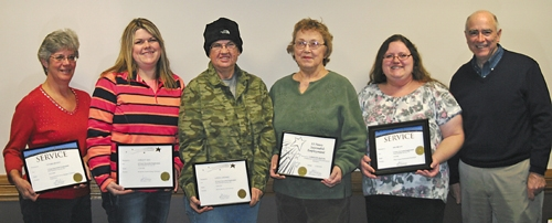 Pathfinder Services employees recognized for their years of service include (from left) Victoria Beaman, Christy Ray, Linda Lindaas, Carolyn Austin and Gina Bryant, with Pathfinder Services President John Niederman.