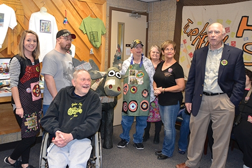 Representatives of Pathfinder Services' Little River Art Studio presented a nearly-life-sized papier maché moose to a representative of the Huntington Moose Lodge on Friday, Nov. 17, a tribute to the day 51 years ago that members of the local organization went door to door throughout the community to enlist 1,001 members and raise funds in order to found an agency that would serve people with disabilities. Making the presentation are (from left) Little River Art Studio representatives Krista Reed, Shawn Kelley, Wayne Wilson, Steve Roush and Rose Mills; Kim Myers, assistant to the administrator at the Huntington Moose Lodge; and John Niederman, president of Pathfinder Services.