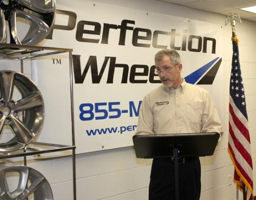 Roger McClellan, president/managing director of Perfection Wheel LLC in Huntington, announces the details of a new $130,000 investment in manufacturing equipment on Friday, Dec. 28.