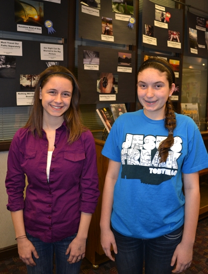 Jessica Fowler (left) and McKenzie Haneline are the winners in the Huntington City-Township Public Library's Teen Photography Contest. Fowler took first place in the senior division, and Haneline was first in the junior division.