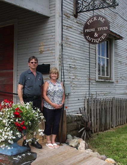 Pick Me Primitives & Antiques owners Rich Tilden (left) and Jenny Tilden stand at their storefront, located at 1021 Division St., Huntington.