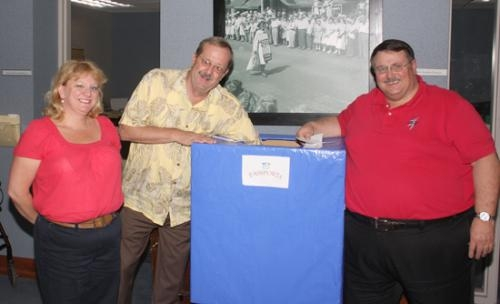 Huntington Mayor Steve Updike (center) draws names from a box for the winners of the 2010 Huntington County Senior Expo Passport Program on Wednesday, May 26, at the Huntington Senior Center. Flanking Updike are Holly Saunders (left) and John Ulrich.