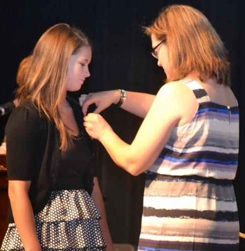 Tiffany Burke (left), one of 35 Huntington North High School students who completed the school's certified nurse aide (CNA) class, receives her CNA pin from health services instructor Tiffanney Drummond, RN,  during a pinning ceremony on Thursday, May 23.