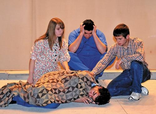 "Jowaun Scher (front) is comforted by (from left) Kylie Tester, Nick Baca and Jonathon Goulding during rehearsal for the Huntington North High School fall play, ""The Diviners."" Performances are Thursday and Saturday, Oct. 11 and 13."