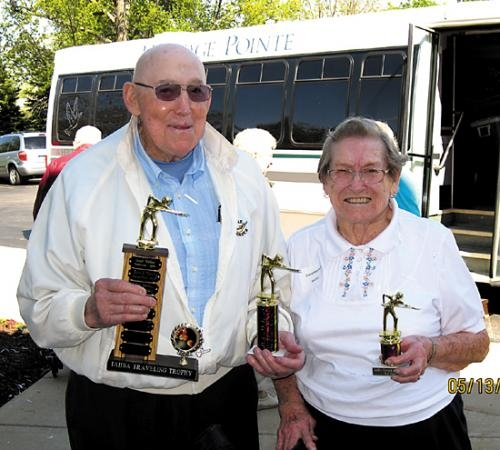 Ralph Taylor (left) won the men's division of the annual IAHSA pool tournament, while Clara Mossburg was the runner-up in the women's division. Both are residents of Heritage Pointe,