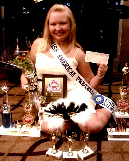 Kalee Pressler displays the awards she won in the Miss American Coed Pageant.