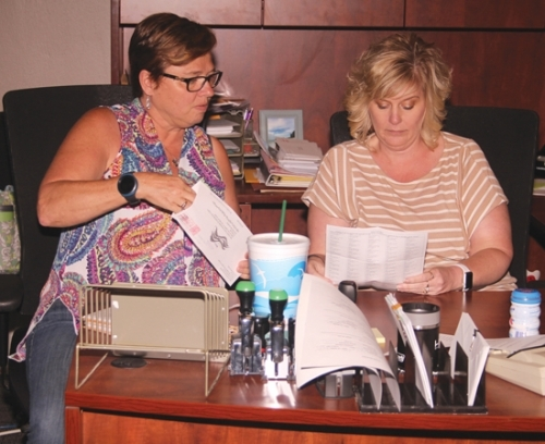 Toni Quickery (left) and Kris Bickel process mailed-in absentee ballots in the Huntington County clerk's office on Election Day, Tuesday, June 2. Due to the COVID-19 pandemic, many voters in Huntington County – 3,080 in all – opted to cast their ballots through the mail rather than venture out to a vote center.
