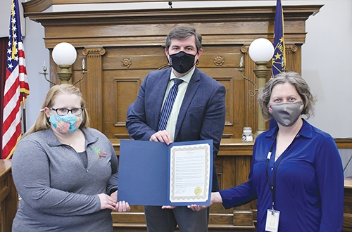 On Thursday, April 1, Huntington Mayor Richard Strick signed a proclamation declaring April as Child Abuse Prevention Month in Huntington. Featured (from left) are McKenzie's Hope Executive Director Katie Schilling, Huntington Mayor Richard Strick and Department of Child Services Local Office Director Kerri  Baker.