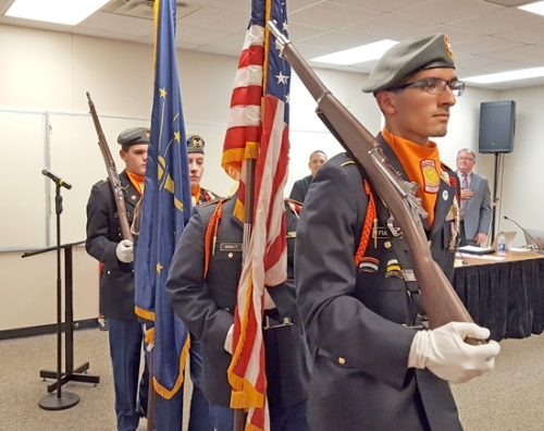 Members of the Warsaw Community High School Junior ROTC color guard enter the boardroom during the start of the Huntington County Community School Corporation's meeting Monday, Sept. 24. Pictured (front to back) are Cadet Maj. Meraley Fugate, Cadet Command Sgt. Zachary Arnett, Cadet Lt. Col. Emily Puckett and Cadet II Lt. Cameron Charles. The cadets spoke with board members, who are considering enacting a JROTC program at Huntington North High School.