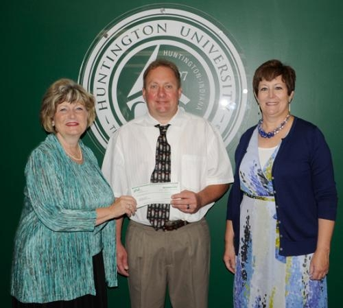 Huntington University President Sherilyn Emberton (left) accepts a contribution from (from left) Thomas Allred, director of operations at PHD Inc., and Marty Songer, PHD Inc. board member, to help fund her inauguration ceremonies on Oct. 4.
