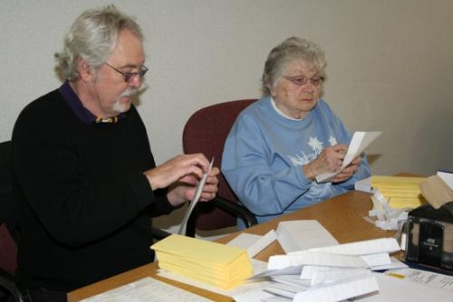 Terry Dailey (left), Class of '66, and Joan Hoover, Class of '50, stuff some of the approximately 600 invitations to the Huntington Township High School reunion coming up April 26 at Habecker Dining Commons on the campus of Huntington University.