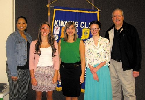 Tinisha Weigelt (left), Roanoke Kiwanis Club president, and Paul Roth (right), club secretary, recently presented scholarships from the club to (from left) Alexis Wygant, Morgan Goetz and Olivia Ely.