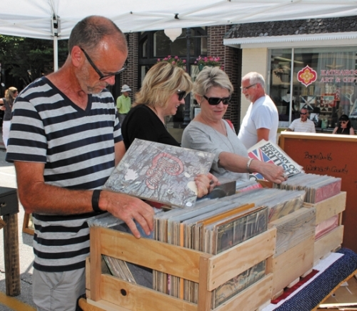 Kevin May, Kelly Mills and Donna Raines (from left) look through cases of vinyl records at last summer's Vintage & Handmade Market in downtown Roanoke. The event returns this year on Saturday, May 20, along with a hog roast sponsored by the Roanoke Volunteer Fire Department and town-wide garage sales.