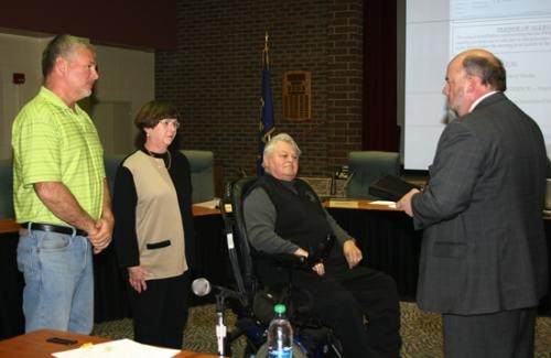 New and returning school board members are sworn in during a special meeting of the board on Wednesday, Jan. 9. Scott Hoffman, District 1; Sarah Kyle, District 6; and Rex Baxter, District 7 (from left) took the oath of office.