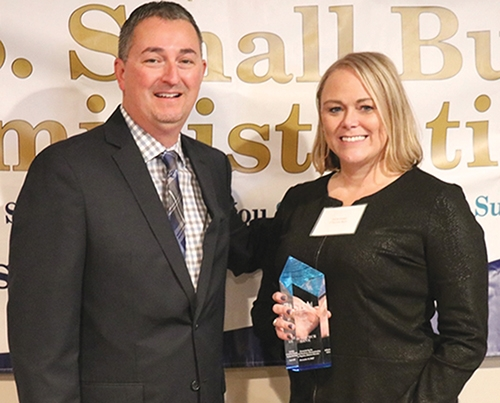 Receiving the Gold Award in the Community Bank category for SBA Lending is Carrie Kosac (right), vice president, small business market manager and Stacey Poynter, SBA Indiana District director of 1st Source Bank.