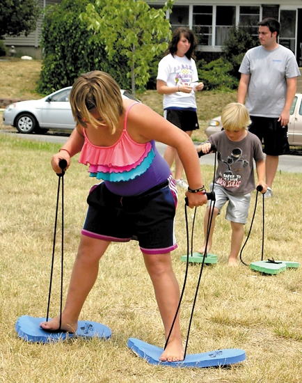 Bryanna Gleba (foreground) and Jacob Ellsworth test their walking skills during the 2012 S.P.A.R.K. program, as program directors Bekah Lantz and Austin Coffey watch. This year's program begins June 3.