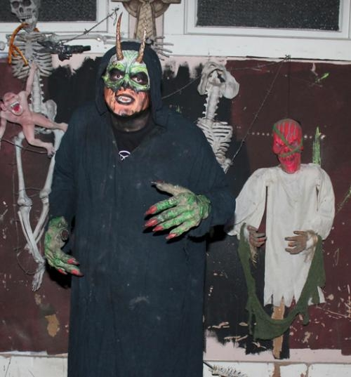 Rufus the Demon, portrayed by Adam Endsley, stands ready to scare patrons of the Haunted Hotel: 13th Floor, in Huntington.