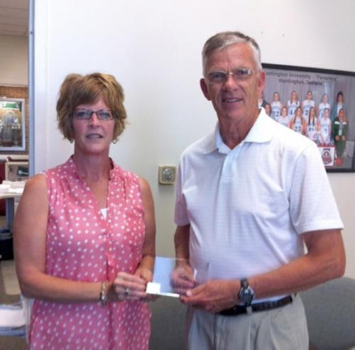 Polly Tribolet (left, photo above) presents a Huntington University Peer Award to Tom King for the month of September.