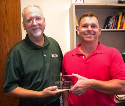 Dr. Michael Cook (left, photo above) received a Huntington University peer award from Dr. Michael Rowley.