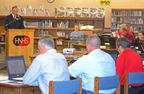 Huntington County Community Schools Corp. Superintendent Tracey Shafer speaks to the school board, including (front from left) Tom King, Ben Landrum and Kevin Patrick, at a board meeting Monday, May 9, at Huntington North High School.
