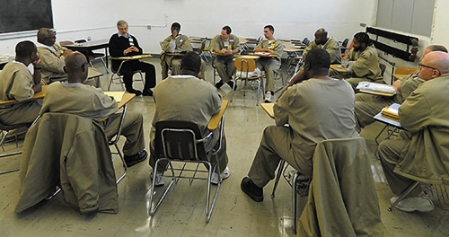 Dr. Jack Heller, a professor at Huntington University, leads a discussion of Shakespeare at the Indiana Correctional Facility in Pendleton.