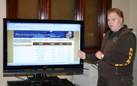 Capt. Steve McIntyre, Huntington County jail commander, explains how to access the link to Sheriff's sales on the county's Web site. McIntyre designed the link, which now gives detailed information on properties that will be sold.