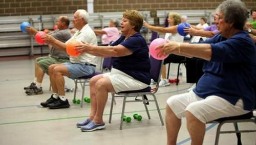 SilverSneakers members participate in strength training exercises. The Parkview Huntington Family YMCA welcomes SilverSneakers by offering two classes to members of the club.