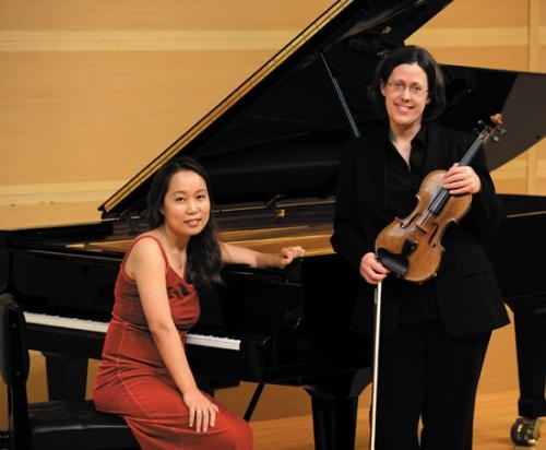 Dr. Ji-Young Jeoung (left) and Elizabeth Smith, both music professors at Huntington University, will perform a free concert on Sept. 20.