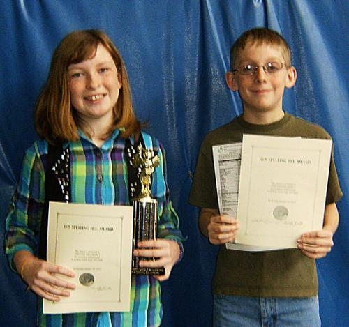 Samantha Ball (left) is Huntington Catholic School's spelling champion. Seth Scheiber (right) is the runner-up.