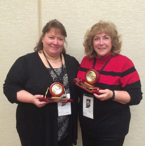 Voter Registration and Election Deputy Pam Fowler (left) and Huntington County Clerk Kittie Keiffer hold their awards received during the Indiana Election Administrators Conference held recently in Indianapolis.