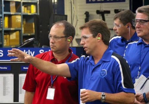 Chris Camp (front right), operations manager of remanufacturing at Bendix, leads U.S. Rep. Marlin Stutzman (front left) on a tour of the Huntington production facility on July 22.