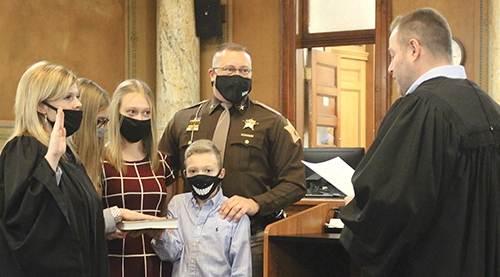Jennifer Newton (left) was sworn in as Superior Court Judge on Thursday, Dec. 31, assisted by her children (from left) Ella Newton, Haley Newton and Zac Newton, as well as her husband, Chris Newton. She was sworn in by circuit court judge Davin Smith.