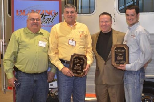T.D. Wall recently received awards from Exiss/Sooner Aluminum Trailers, Inc. Pictured (from left) are Don Wall and Tom Wall of T.D. Wall Inc., National Sales Manager Blake Hurlbutt of Exiss/Sooner, and Tommy Wall of T.D. Wall Inc.
