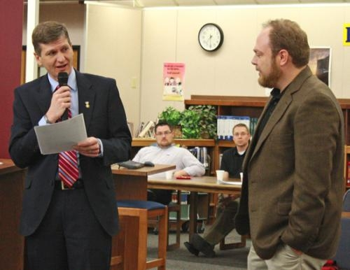 Huntington North High School Principal Jeremy Gulley (left) congratulates newly-named HNHS Teacher of the Year Dominick Manco. Manco has taught at HNHS since 2007.