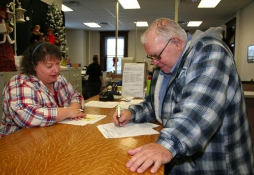 Raymond R. Tackett (D) files his intention to run for the Andrews town clerk-treasurer's office, one of the first candidates to file for the 2015 general election in November. Assisting Tackett is Pam Fowler, voter registration and election deputy in the Huntington County Clerk's Office.