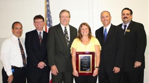 Diana Sowers (fourth from left), a teacher at Roanoke Elementary School, is the Huntington County Community School Corporation's teacher of the year for 2013.
