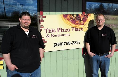 Eric Carter (left) and Ryan Suman are co-owners of This Pizza Place & Restaurant, in Markle. The men say that they have revamped the interior and added a new menu.