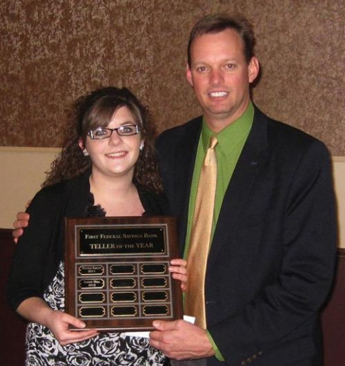First Federal Savings Bank President and CEO Michael Zahn recognized Addey Hill as Teller of the Year, during the bank's Christmas party on Dec. 12. Several other employees were recognized at the party.