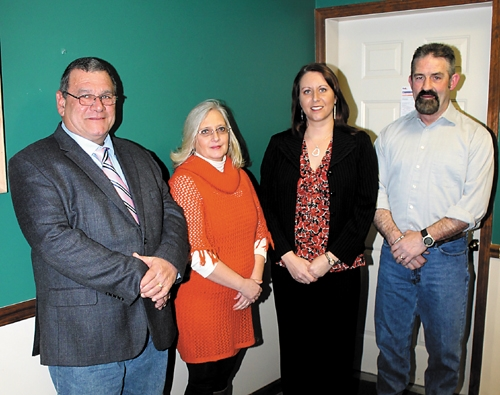 Bob Troyer Realty, in Huntington, has expanded its staff to include sales associates (from left) Gary Scare, Belinda Clancy, Christina Hosler and Pat Randolph.