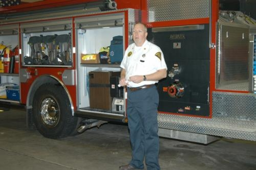 Robert Gonser, president and chaplain of the Markle Volunteer Fire Department, dedicates the department's newest fire truck during a ceremony on Monday, Dec. 21, at the Markle Fire Station.