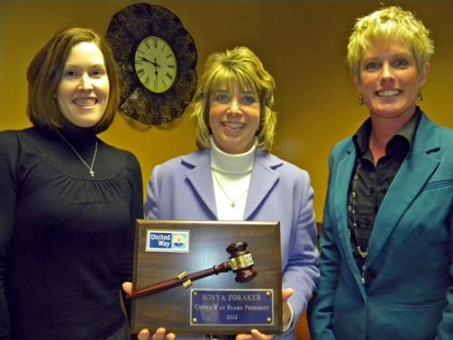 Sonya Foraker (center), retiring president of the board of directors for the United Way of Huntington County, is flanked by new board president Annette Carroll (right) and vice president Megan Bobay (left).