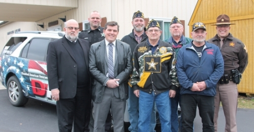 Dedicating the vehicle that will be used to begin the new VTN – Veterans Transport Network – in Huntington County are members of American Legion Post 7 and other local officials who helped get the free service going for veterans. Celebrating the occasion are (front row from left) former Huntington Mayor Brooks Fetters; current Mayor Richard Strick; Steve Garwood, second vice of Post 7; and VTN Coordinator Curt Juergens; and (back row from left) Chad Hammel, chief deputy of the Huntington County Sheriff's Department; Post 7 Commander Stan Klosowski; Ed Hippensteel, Post 7 chaplain; and Huntington County Sheriff Chris Newton.