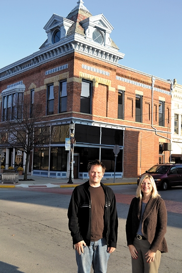 Rich Najuch (left), board president of the Huntington County Visitor Bureau, and Tina Bobilya (right), the bureau's executive director, stand in front of the building the Visitor Bureau is offering to a business rent free for a year.