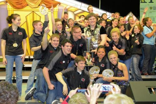 Members of the Huntington North High School Varsity Singers celebrate their wins at the Norwell Invitational on March 9.