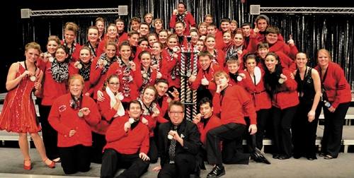 The Huntington North High School Varsity Singers pose with their trophy after being named overall grand champion during the Northridge High School Invitational on Saturday, Feb. 15.