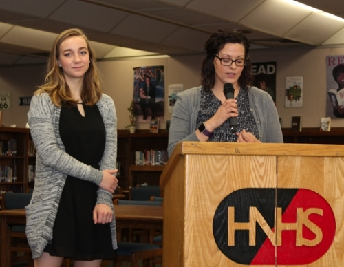 Emma Helmich (left), the 2017 Huntington North High School salutatorian, smiles as HNHS Guidance Counselor Stephanie Rodgers reads off her list of accomplishments during the Valedictorian-Salutatorian-Teacher of the Year breakfast held Wednesday, April 19, in the high school's media center.